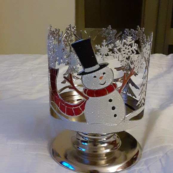 It's a Christmas pedestal 3 wick candle holder